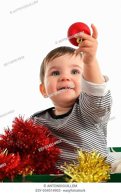 Eight months baby inside a box showing a christmas ball in a white background