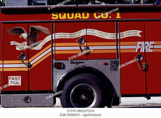 Part view of fire engine painted with Bald Eagle carrying banner listing some of the New York fire officers killed in the September 11th 2001 World Trade Tower...