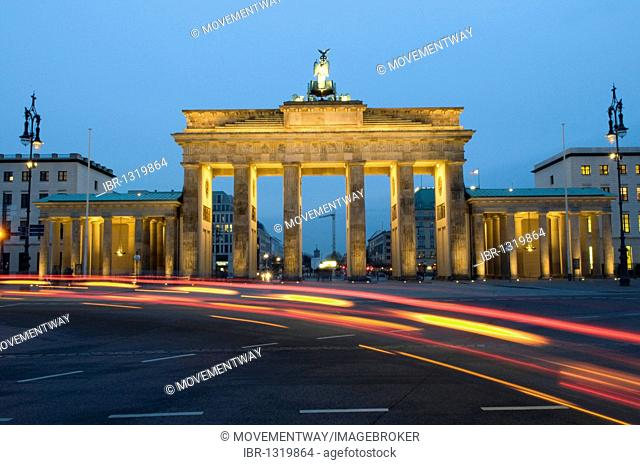 Traces of light at the Brandenburg Gate at night, Berlin, Germany, Europe