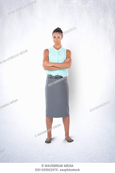Businesswoman standing in white room