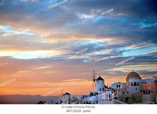 Oia Ia Santorini - Windmills and town at sunset, Greek Cyclades islands