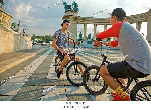 BMX cyclist resting, Heroes' Square (Hosök Tere), Budapest, Hungary