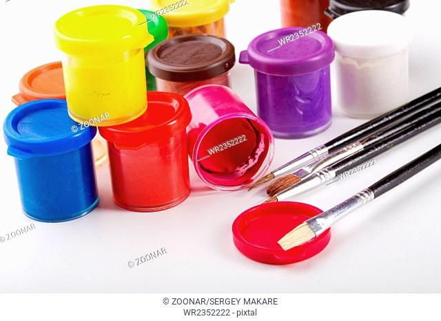 Jars of gouache and brush for drawing