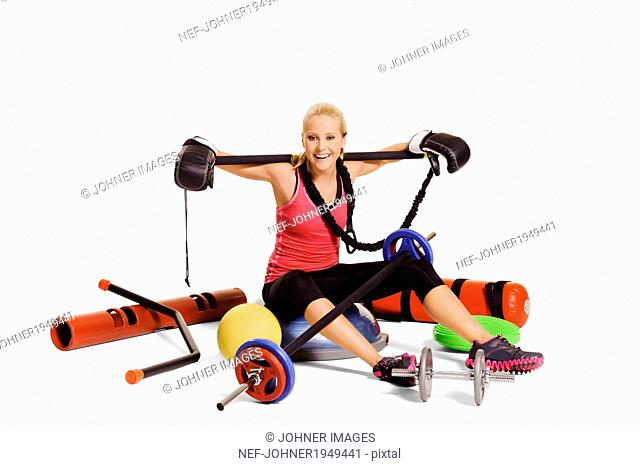 Young woman with training equipment, studio shot