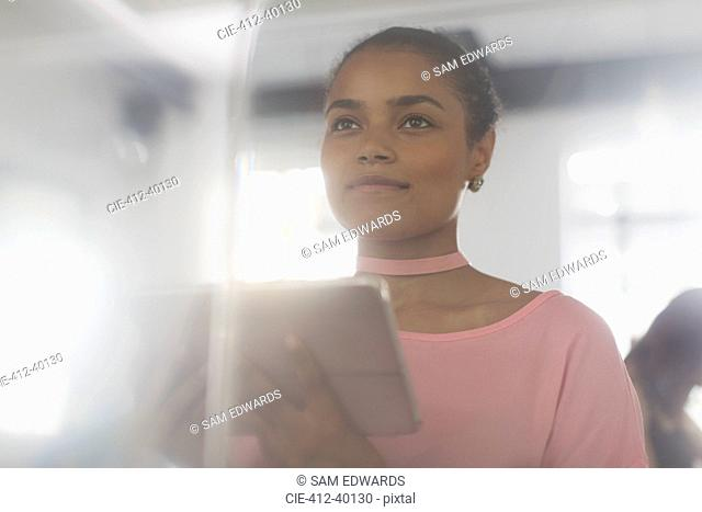 Ambitious businesswoman with digital tablet