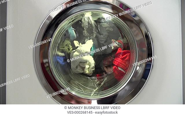 Slow motion sequence of clothes being washed in machine. Shot on Sony FS700 in PAL format at a frame rate of 25fps