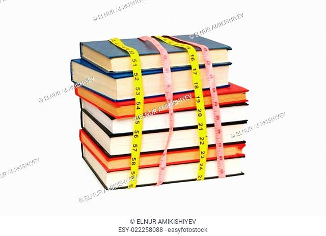 Measuring the knowledge - concept with books on white