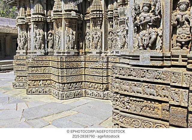 Close up of deity sculpture under eves on shrine outer wall in the Chennakesava Temple, Hoysala Architecture at Somnathpur, Karnataka, India