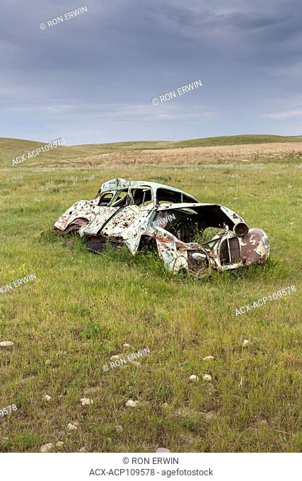 Abandoned old junk car on a field in southern Saskatchewan, Canada