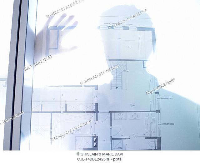 Silhouette of a man,blue prints in front