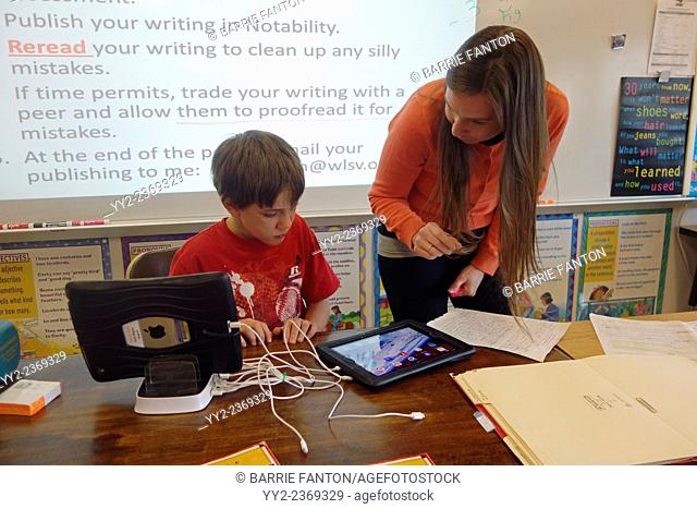 6th Grade Boy and Teacher in Classroom, Wellsville, New York, United States