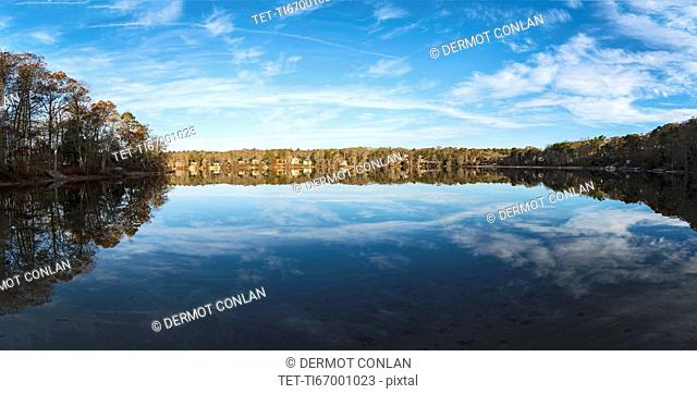 USA, Massachusetts, Cape Cod, Falmouth, Panoramic view of pond with reflection