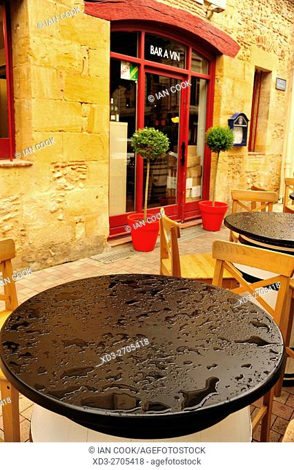 outdoor cafe tables in rain, Bergerac, Dordogne Department, Aquitaine, France