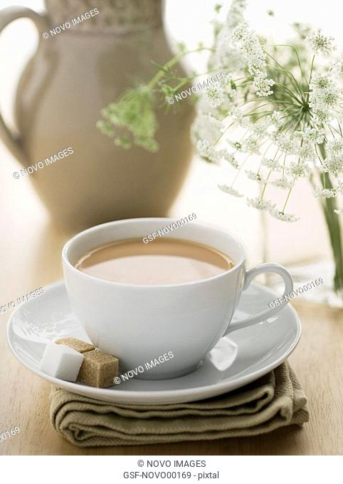 Cup of Coffee on Sunny Table