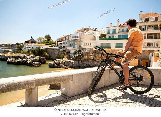 Cyclist in Cascais, Rainha Beach, Lisbon District, Portugal