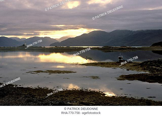 Sunrise over Isleornsay and lighthouse, Knoydart mountains behind, Isle of Skye, Inner Hebrides, Scotland, United Kingdom, Europe