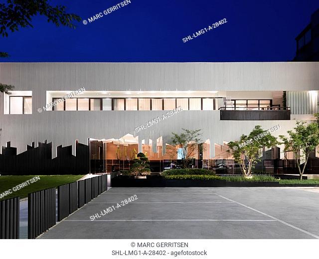 Front elevation of modern building at dusk