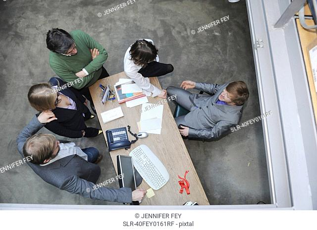 Overhead view of business people at desk