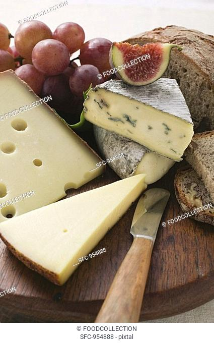 Cheese board with grapes, fig and bread