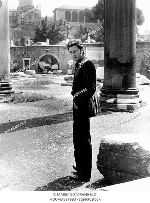 Andrea Giordana at the Trajan's Forum in Rome. Italian actor Andrea Giordana posing at the Trajan's Forum. Behind him, a column. Rome, 1975