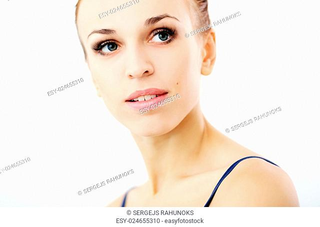 Portrait of a beautiful girl who is looking away over a white background