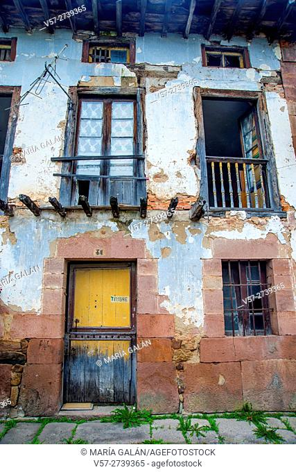Facade of house in ruins. Carrejo, Cantabria, Spain