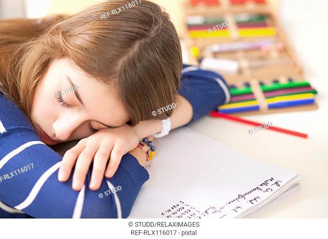 Girl sitting at desk sleeping