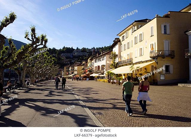 View along harbour promenade with pavement cafes, Ascona, Lago Maggiore, Ticino, Switzerland