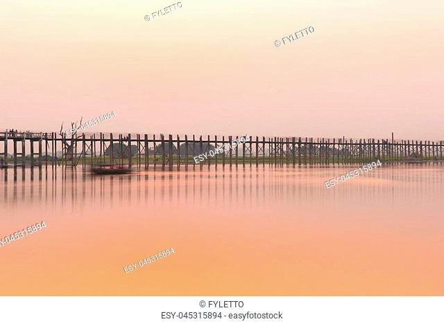 Sunset over U Bein Bridge over Taungthaman Lake in Myanmar