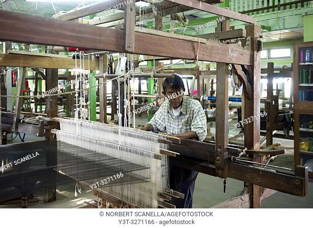 Myanmar (ex Birmanie). Amarapura, region of Mandalay. Man working in weaving workshops
