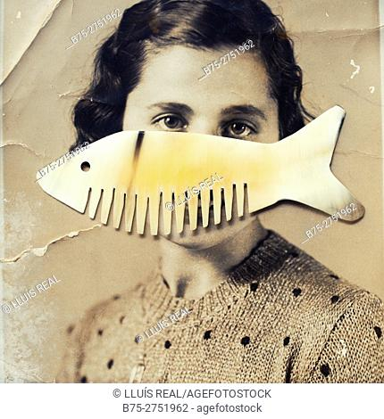 Old black and white portrait of woman with fish-like comb on her mouth