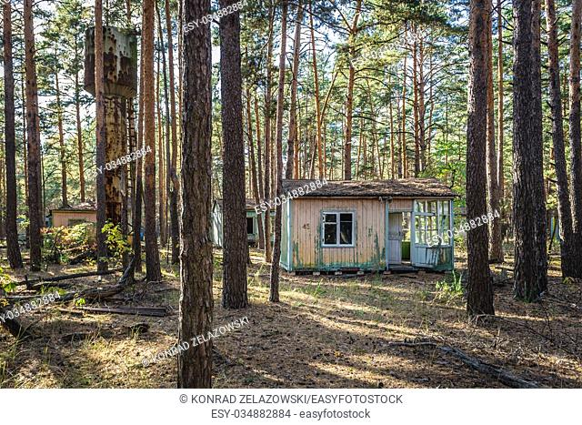 """Water tower and houses in """"""""Emerald"""""""" recreation base in Chernobyl Nuclear Power Plant Zone of Alienation around nuclear reactor disaster in Ukraine"""