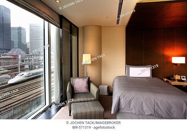 Four Seasons at Marunouchi Hotel at Tokyo Station, with a view of the Shinkansen high-speed rail line, Tokyo, Japan, Europe