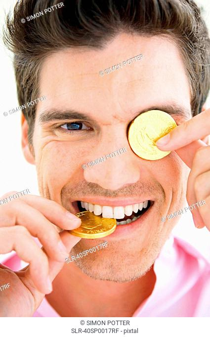 Man playing with gold coins