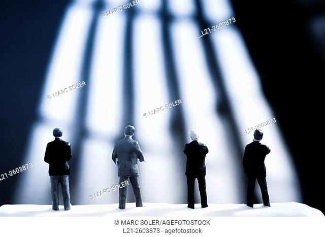 Figurines of businessmen watching a blurred background of lines and shadows. Toy businessmen team, silhouettes of men