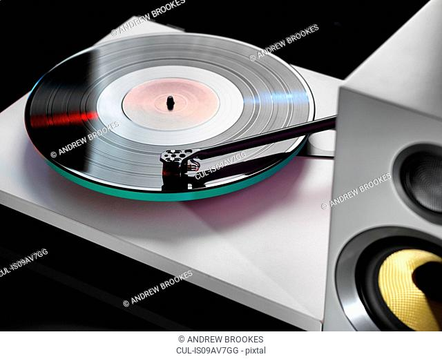 Close up of hi-fi speakers with a stylus playing a record