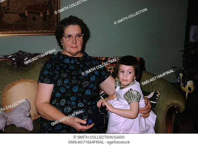 Vernacular snapshot image of granddaughter and grandmother, 1963