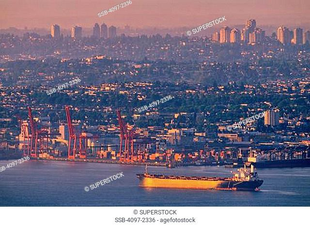 Container ship in the sea at sunset, Burrard Inlet, Vancouver, British Columbia, Canada