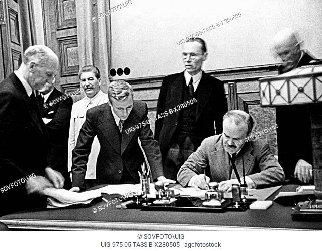 Vyacheslav molotov, chairman of the people's commissars' council and people's commissar for foreign affairs, signing of the treaty of non-aggression between...