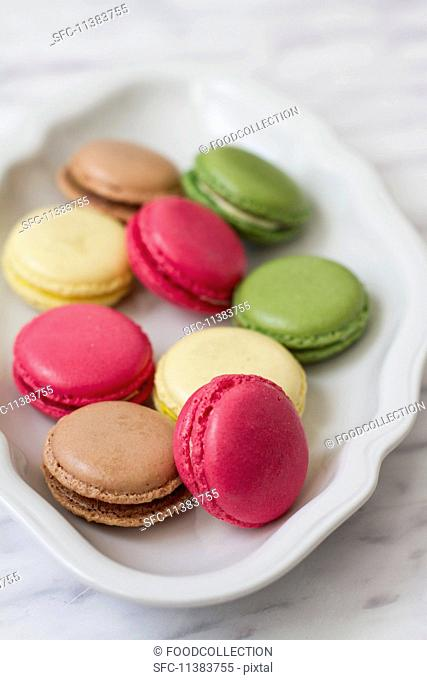 Various different coloured macaroons on a plate