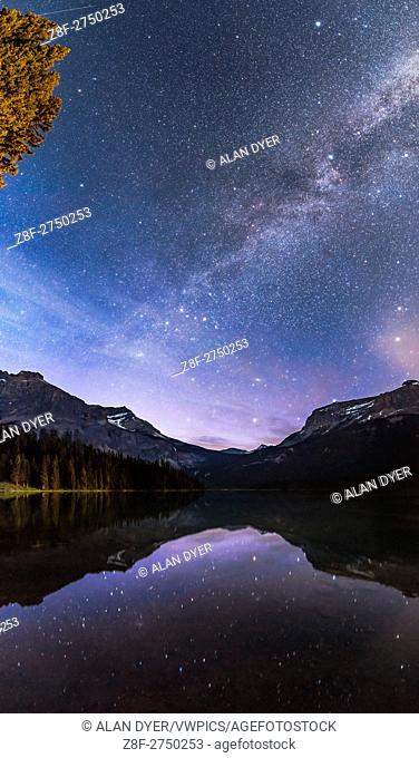 The stars of Cassiopeia (the â. œWâ. . at centre) and the other stars of the summer and autumn sky reflected in the still waters of Emerald Lake