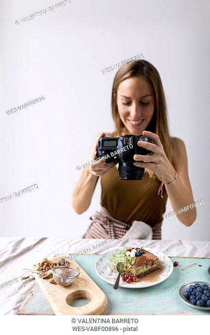 Woman photographing vegan matcha cake