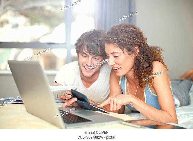 Young couple planning finances