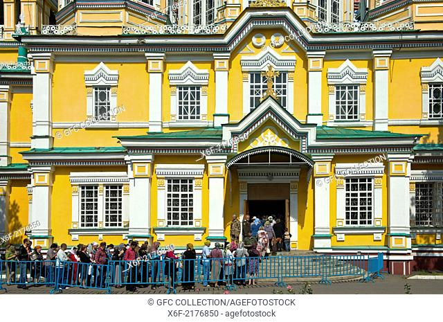 Believers lining up at the entrance to the Ascension Cathedral, Zenkov Cathedral, Almaty, Kazakhstan