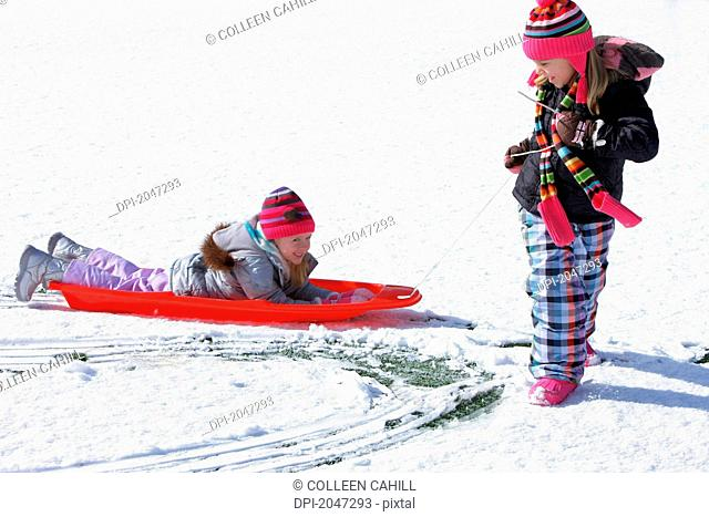 Two Girls Playing In The Snow, Troutdale Oregon United States Of America