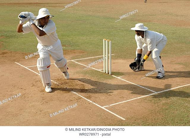 Indian left handed batsman in action playing cover drive shot in cricket match MR705L