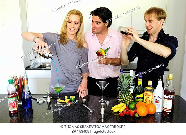 Friends at the bar mixing drinks