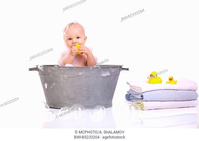 Bath Time. Cute happy baby girl having bath