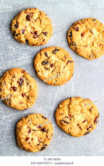 Sweet cookies with raisins on old kitchen table