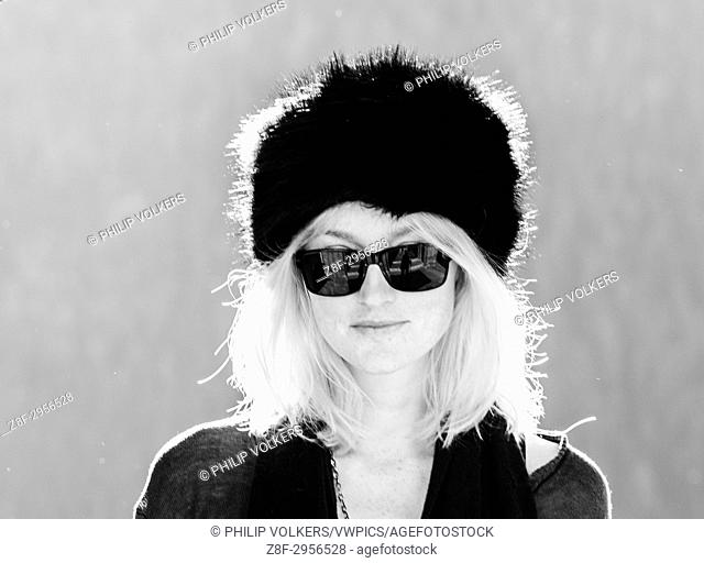 Black and white shot of young blonde girl with russian hat